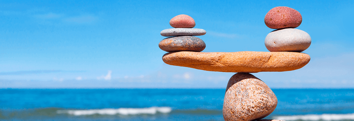 Rocks Balancing On Each Other On The Beach