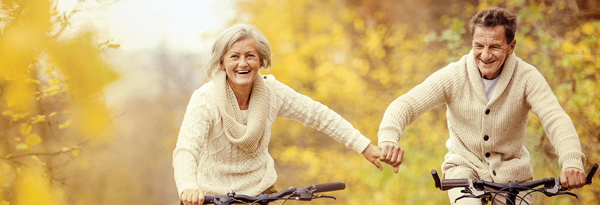 A Retired Couple Enjoying A Bike Ride